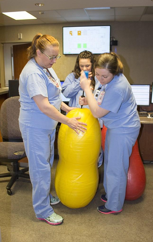 Nurses inflating a large peanut ball