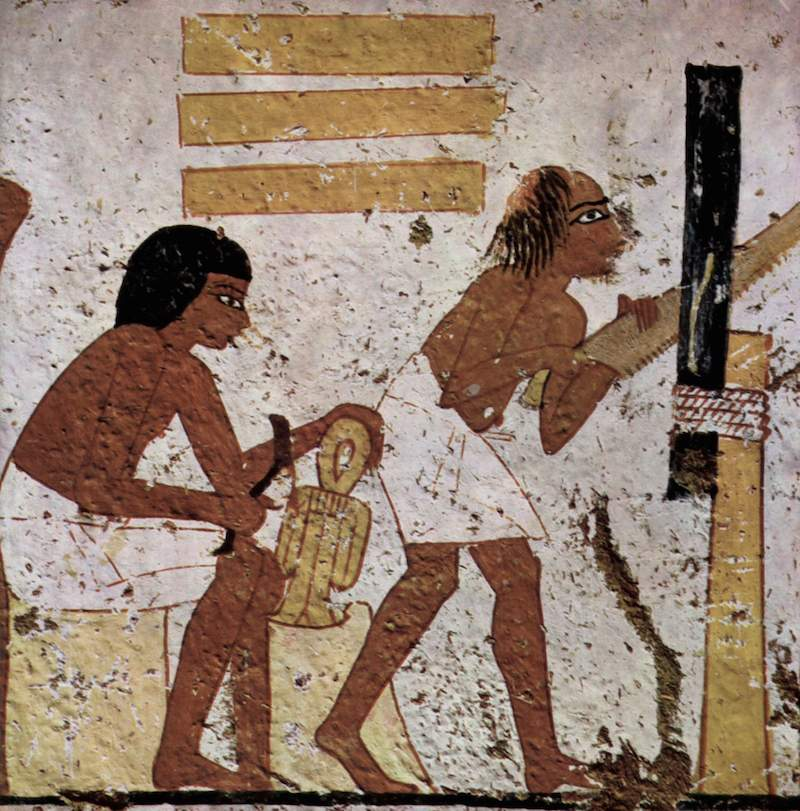 Craftsman working on the Tyet of the Egyptian Goddess Isis. Tomb of Nebamun