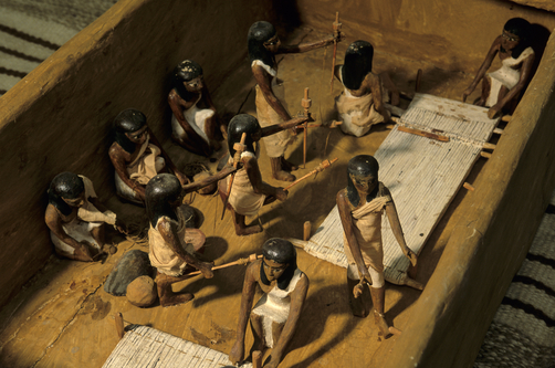 Wood model of weavers from Tomb of Meketre. KENNETH GARRETT/National Geographic Creative