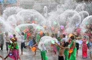 Thai community splashing each other with water.