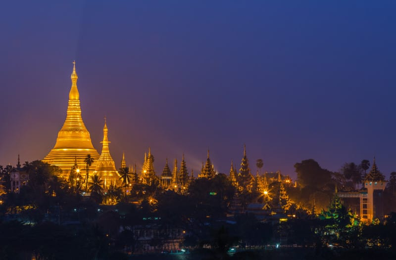 Shwedagon Pagoda in Yangon City, Burma with Beautiful Evening Light: the beautiful golden pagoda, the oldest historical pagoda in Burma and the world, in the evening with great evening light.