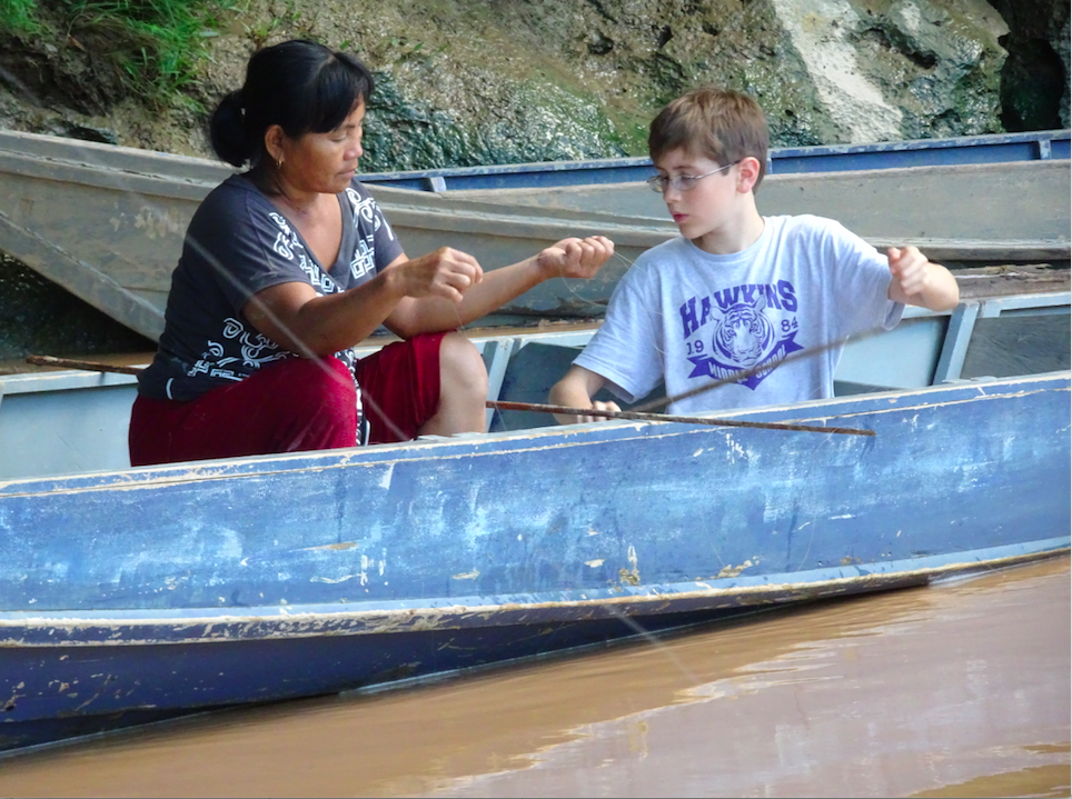 Boy connecting with local people in Sapulot, Borneo