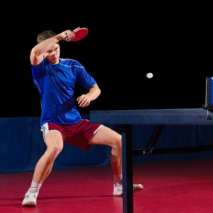 table tennis player sitting down