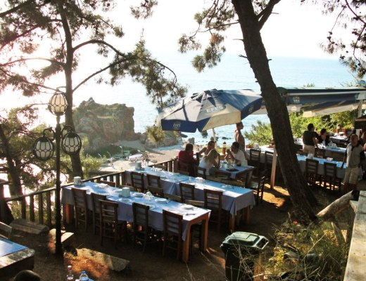 a restaurant with a sea view
