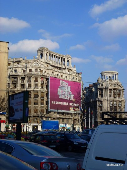Quintessential Bucharest: trashy new banners on decrepit old buildings.