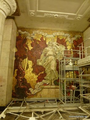 Repairs being done to a mosaic in Avtovo metro station.