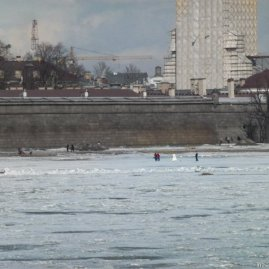 A wedding party playing on the frozen river.
