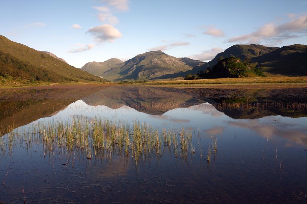 Mountains reflected in Lochan nan Gabhar in Glen Gour, Ardgour