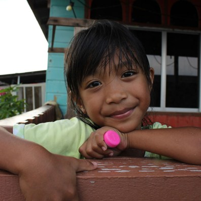 Portrait of a cute little girl met in Kampong Ayer, Brunei.