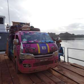 On the barge crossing the Essequibo River, at Mango Landing