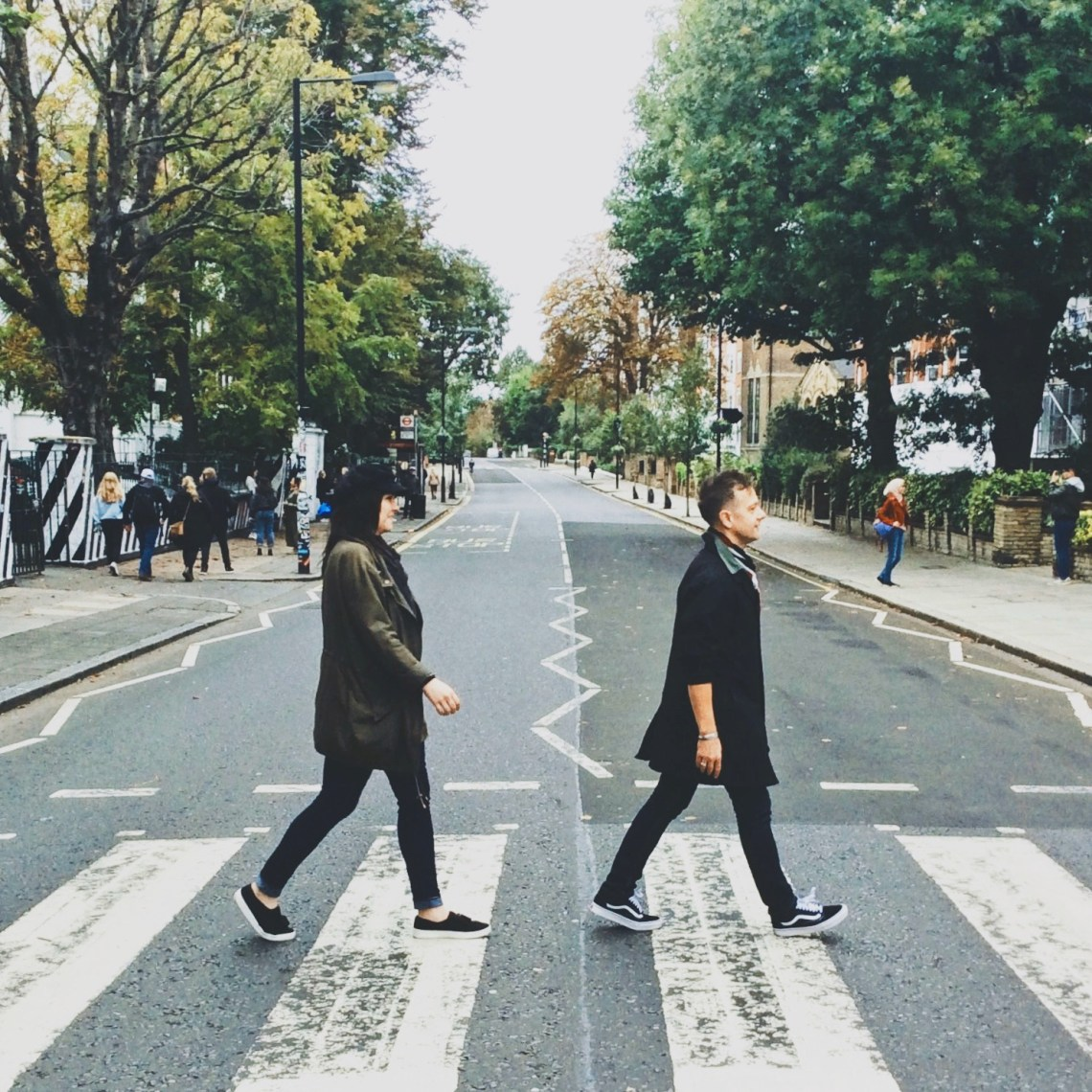 Stephen & Andie cross the street at the famous Abbey Road crossing in London, England