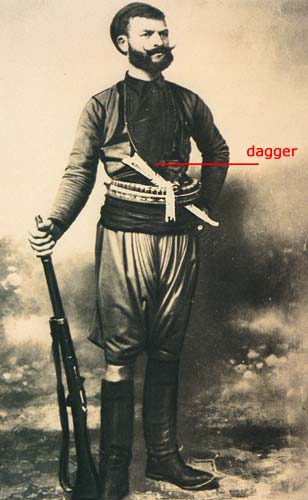 Old Photo of man from Crete with his dagger and other weapons