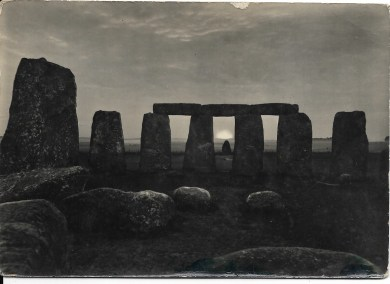 Early 20th Century postcard of Stonehenge at sunset.