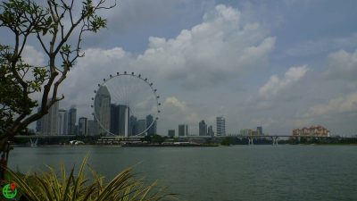 Singapore flyer, sea water and cloudy sky