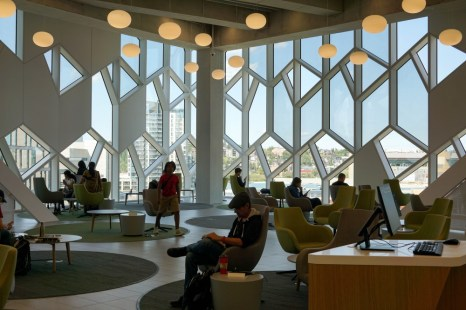 armchairs in a city library with cityscape in the background - free things to do in Calgary on one day