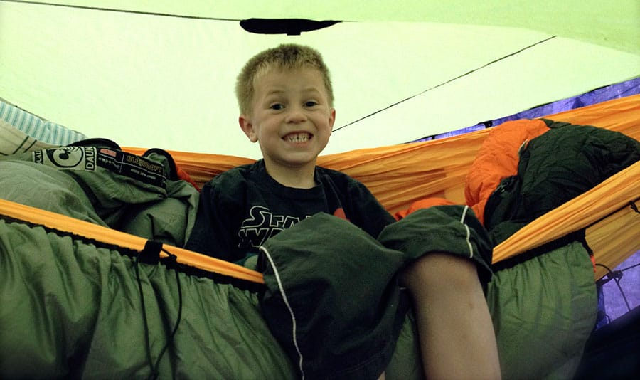 children camping in backpacking hammock