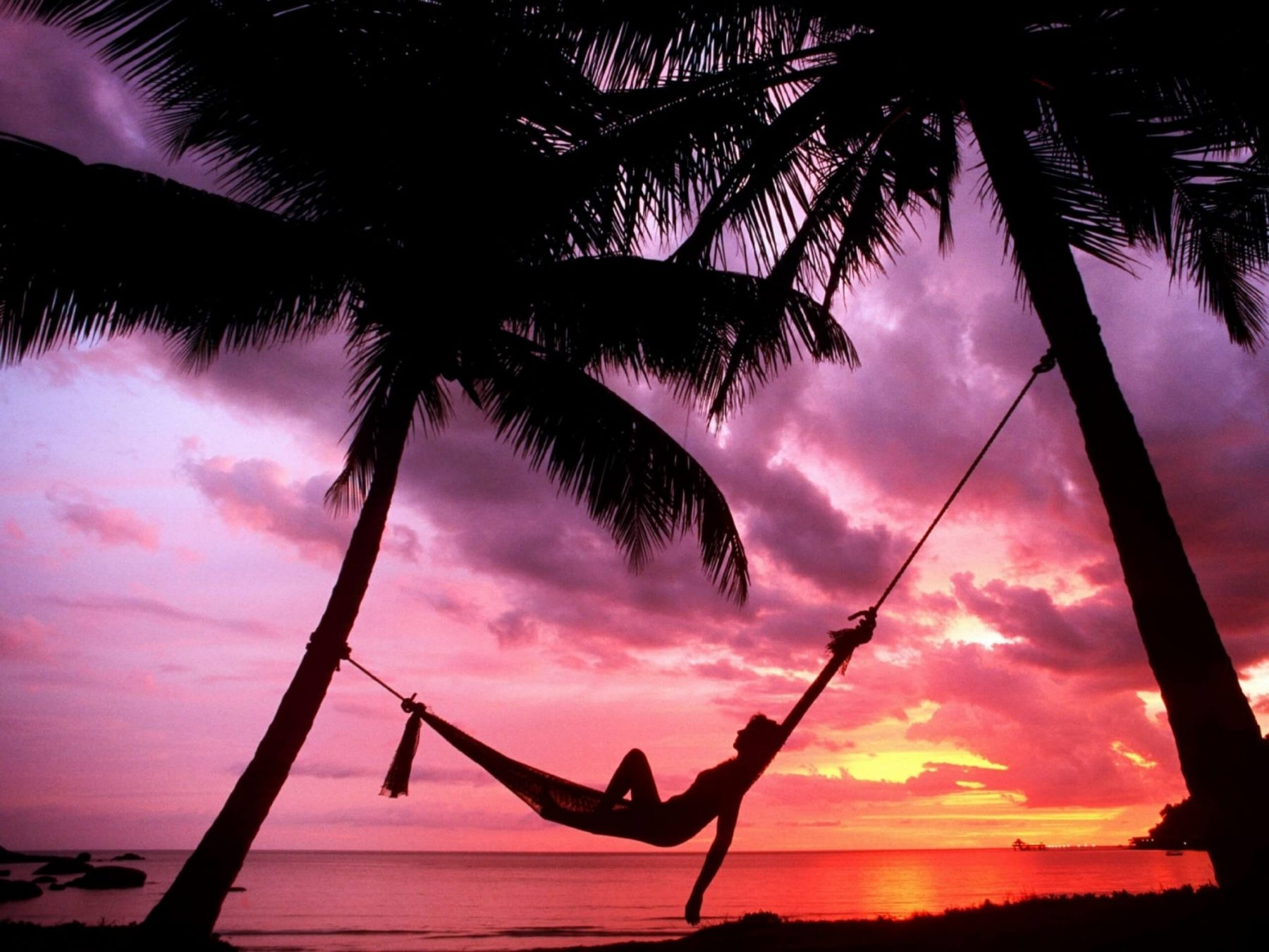 sunset beach chillout on a rope hammock