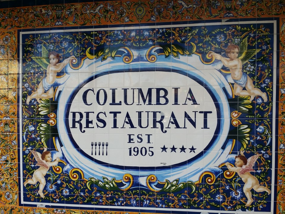 shows hand painted tiles on the sign for the Columbia Restaurant at our road trip stop in Ybor City