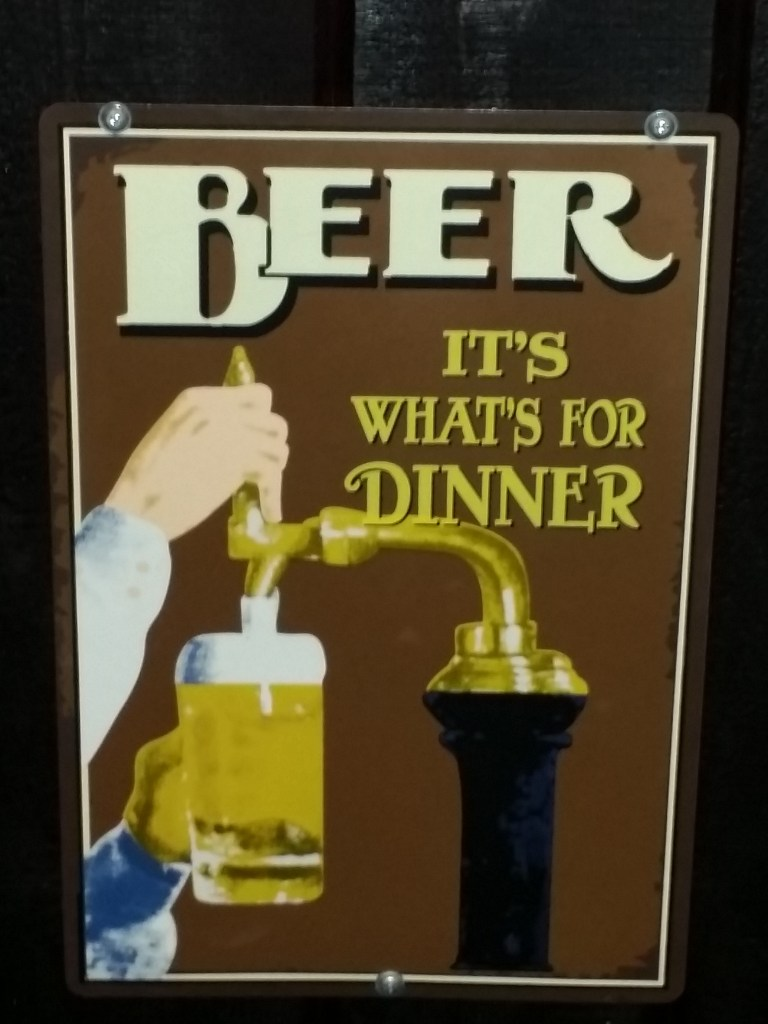 """Depicts a sign saying """"Beer, its what's for Dinner"""" at Tampa Bay Brewing Company"""