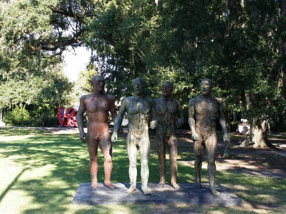 sculpture of four nude men in the sculpture garden at New Orleans Museum of Art