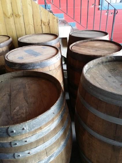 displays rum barrels at Old New Orleans Rum Distillery