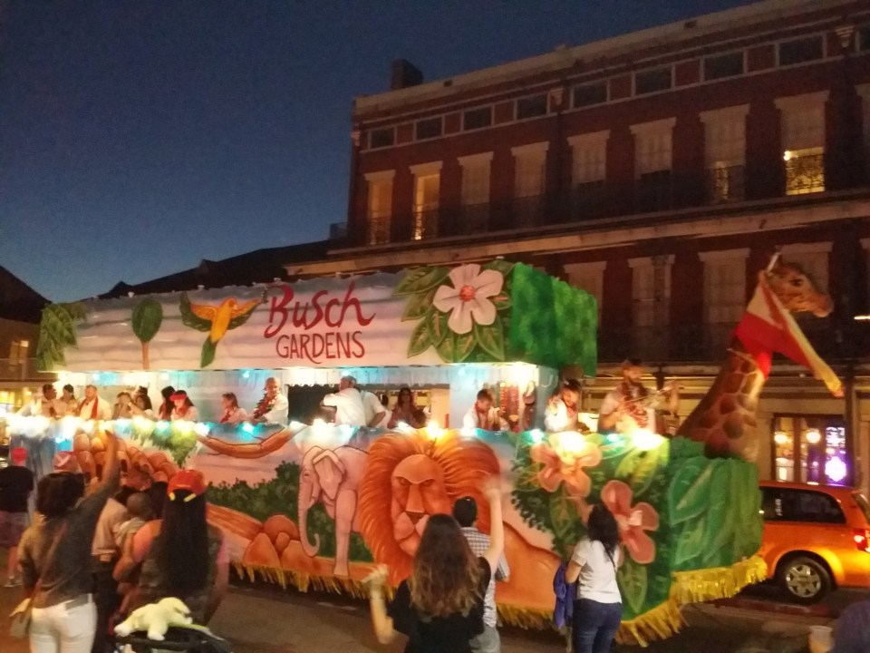 a Busch Gardens float moves down the street during a random parade outside Jax Brewery, New Orleans