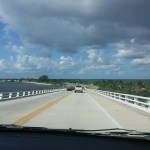 shows the road to Sanibel from the passenger seat of a vehicle