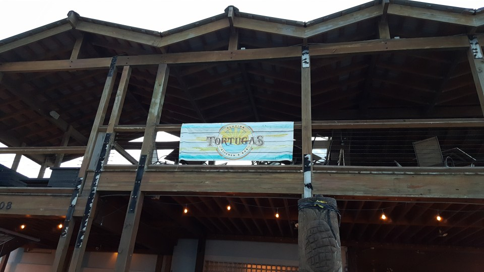 shows the two story Tortugas restaurant on Flagler Beach