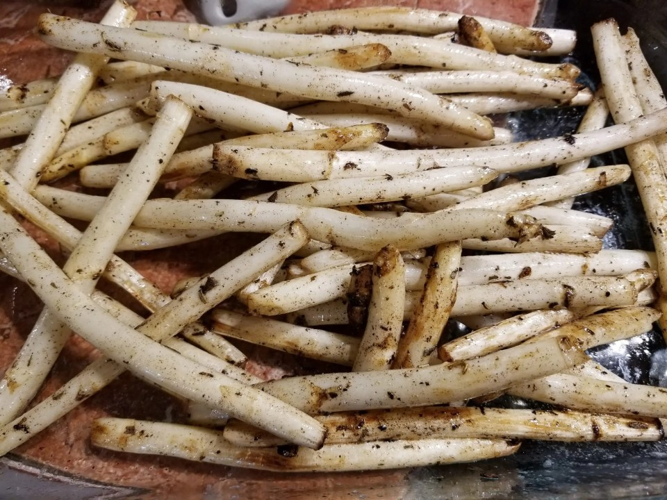 photo from article on French food recipes showing sauteed white asparagus in a serving dish