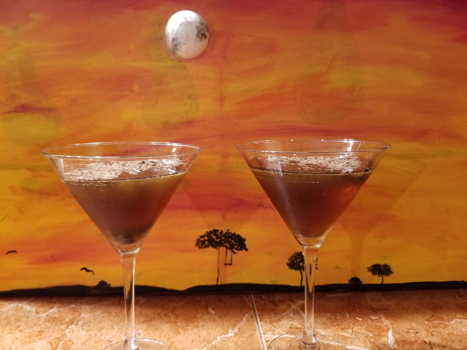 shows a picture of some Halloween cocktails inspired by chocolate coconut candy bars