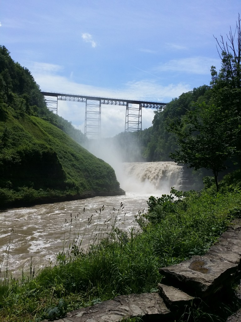 shows the old train brdge high above the falls at Letchworth State Park New York