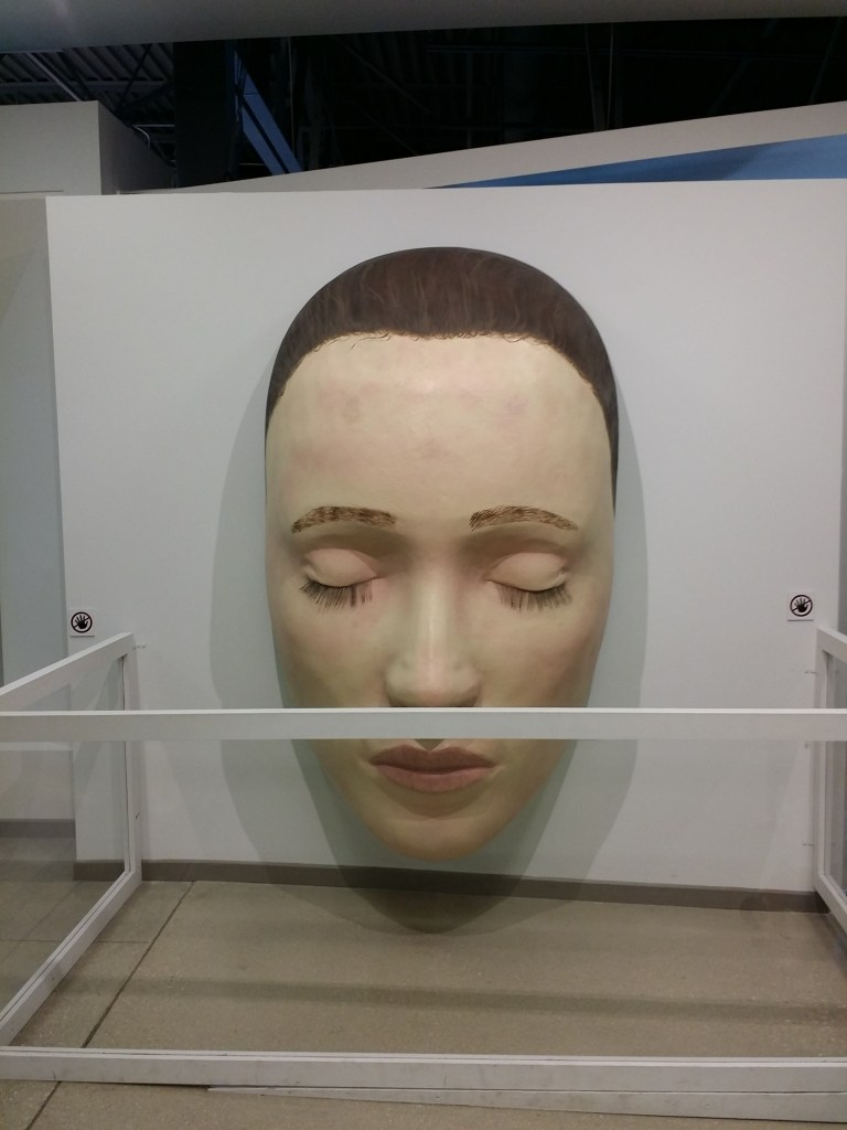 South Florida for families has a lot to offer. Here is a giant face on display at Young at Art