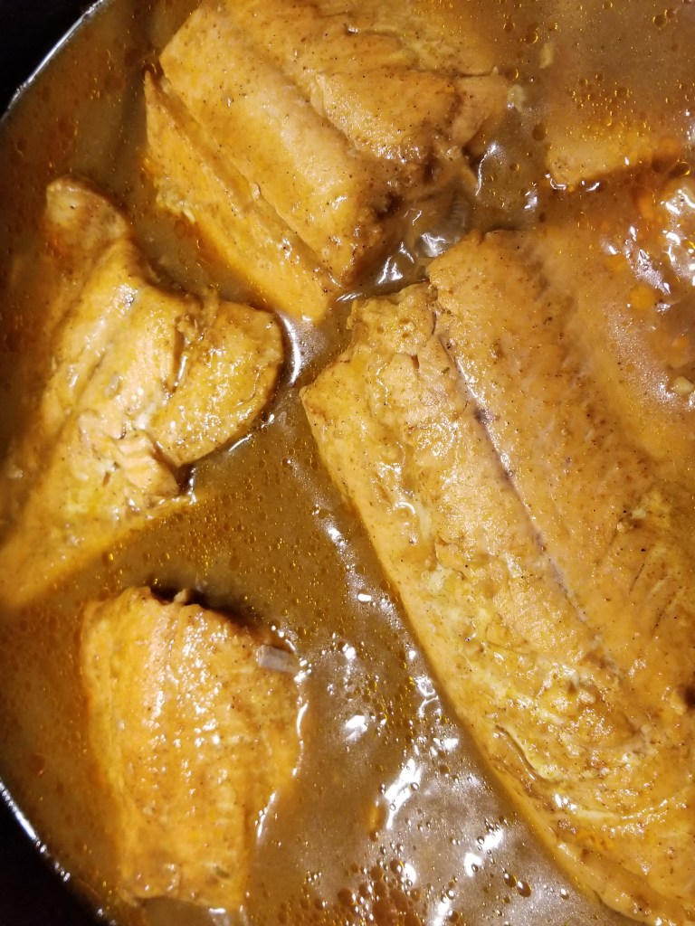 homemade Indian food of salmon curry in a pan