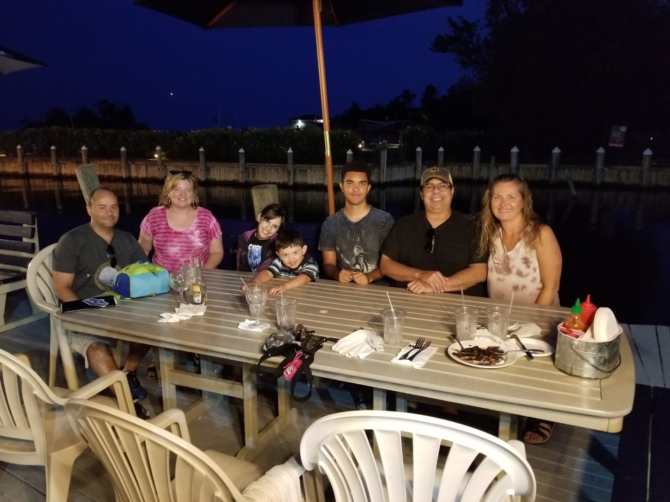 A family eating dinner at an outdoor restaurant on South Shore Long Island