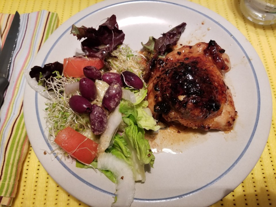 shows lemon chicken with Mediterranean Salad on a plate