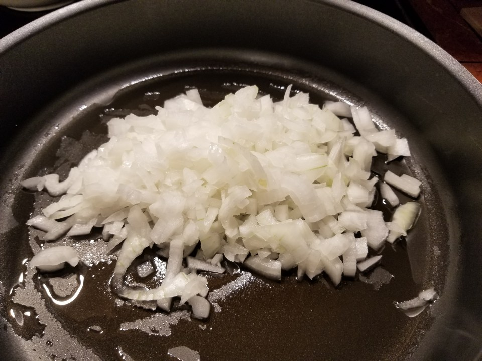 diced onions cooking to make picadillo