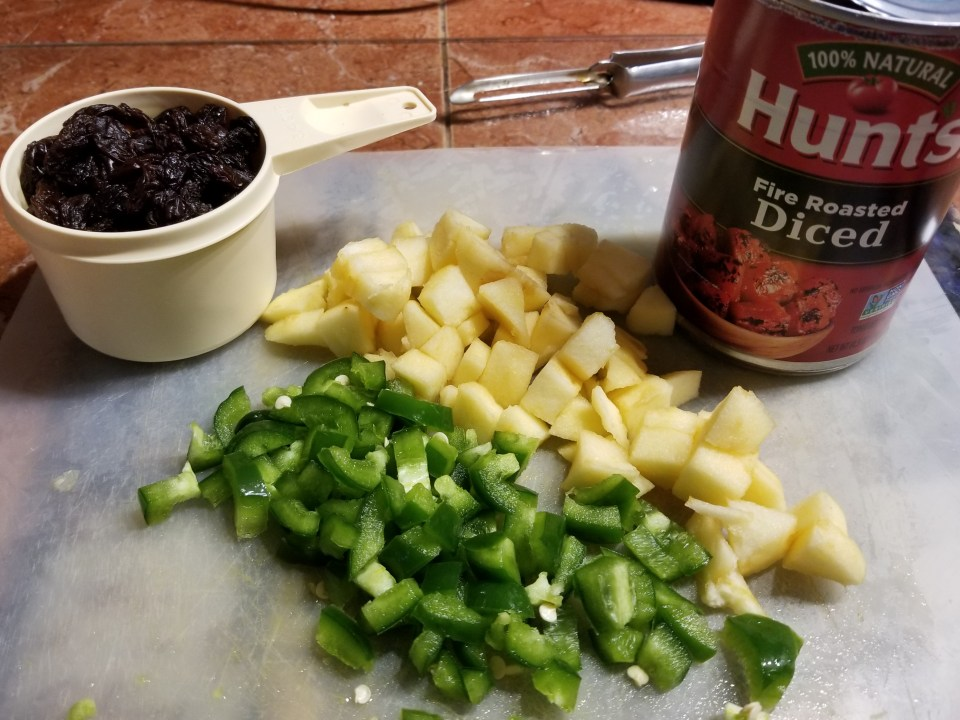 ingredients to make picadillo: peppers, apples, diced tomatoes