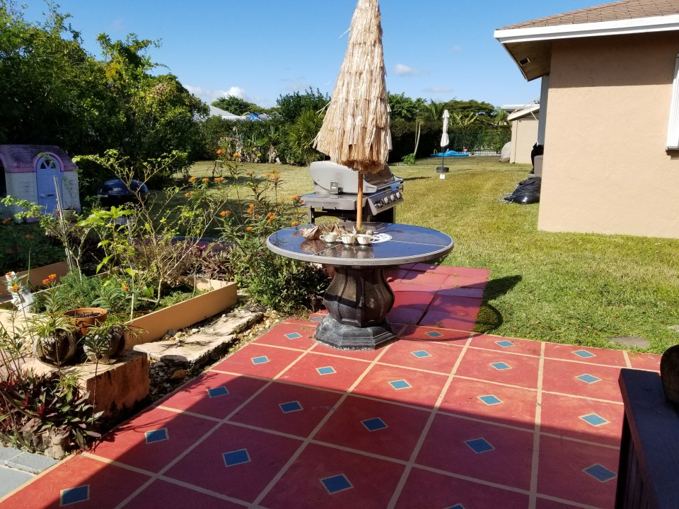 living in south Florida leads to outdoor patio spaces for grilling year round. This one shows hand painted Mexican tile design