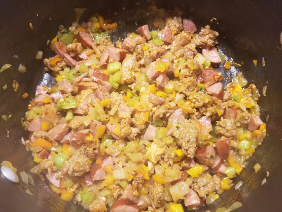 mixture of veggies and sausage in a pot in preparation for making southern soul food recipe for jambalaya