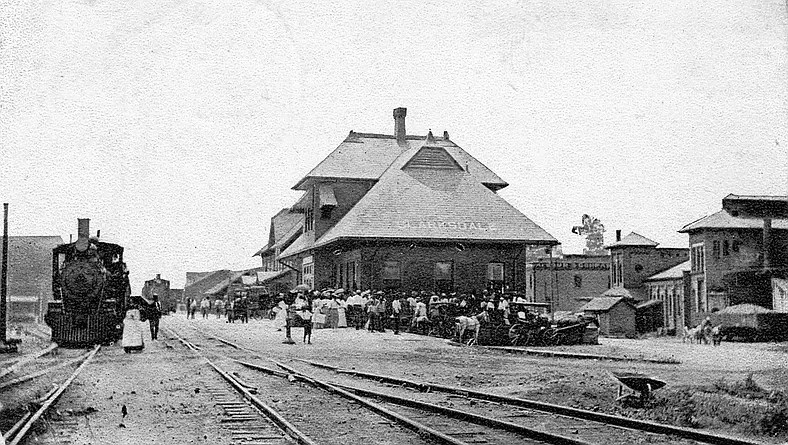 Shows an original photo of the train depot that later became the delta blues museum