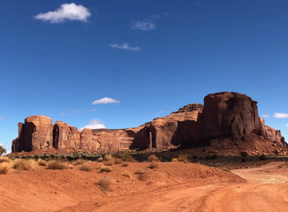 Shows rock formations in Monument Valley, one of the best places to visit in Arizona