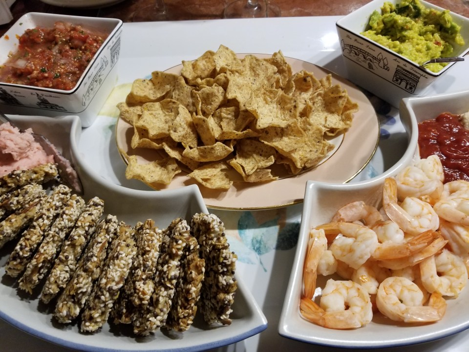 world appetizer ideas from Mexico: a platter with chips, homemade salsa, guacamole, shrimp with spicy sauce and oat crackers with Mexican cheese