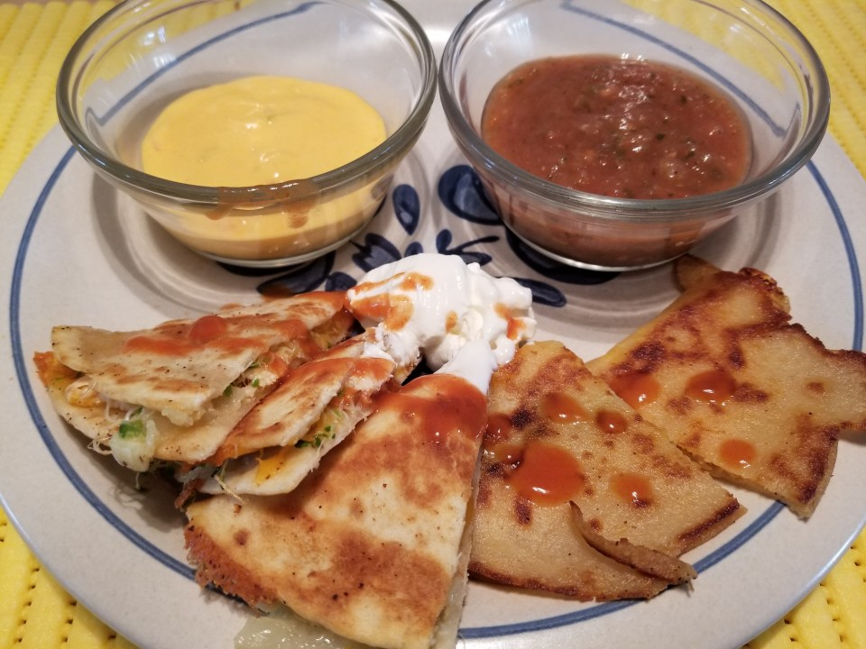 shows chicken quesadillas with salsa and nacho cheese sauce