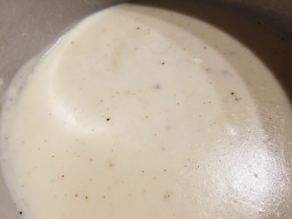 classic food in Greek, white Bechamel sauce in a pan