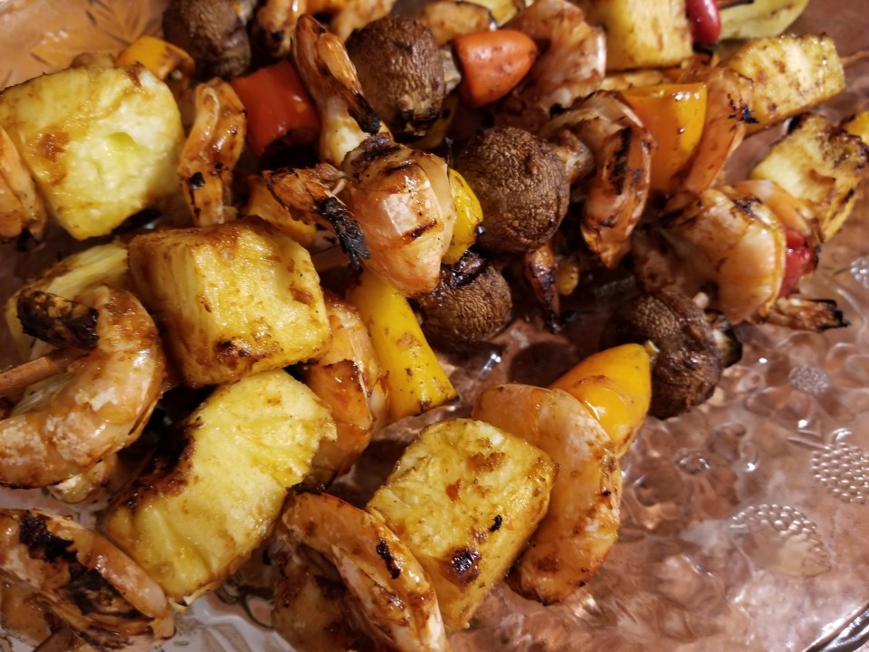 Grilled BBQ shrimp kabobs with pineapple, mushrooms, and peppers