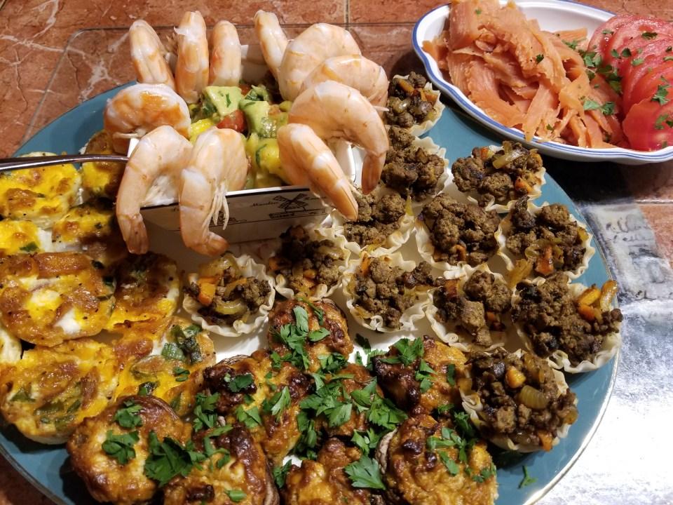 Australian appetizer ideas including stuffed mushrooms, bacon quiche, meat pies, shrimp with mango avocado salsa, and gravlox