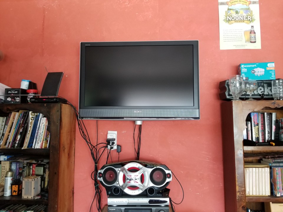 old tv and boombox for entertainment in garage mancave