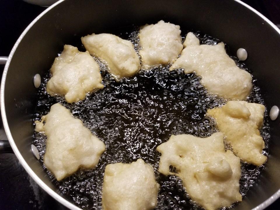 loukamathes, dessert in Greek, dough balls cook in a pot of oil