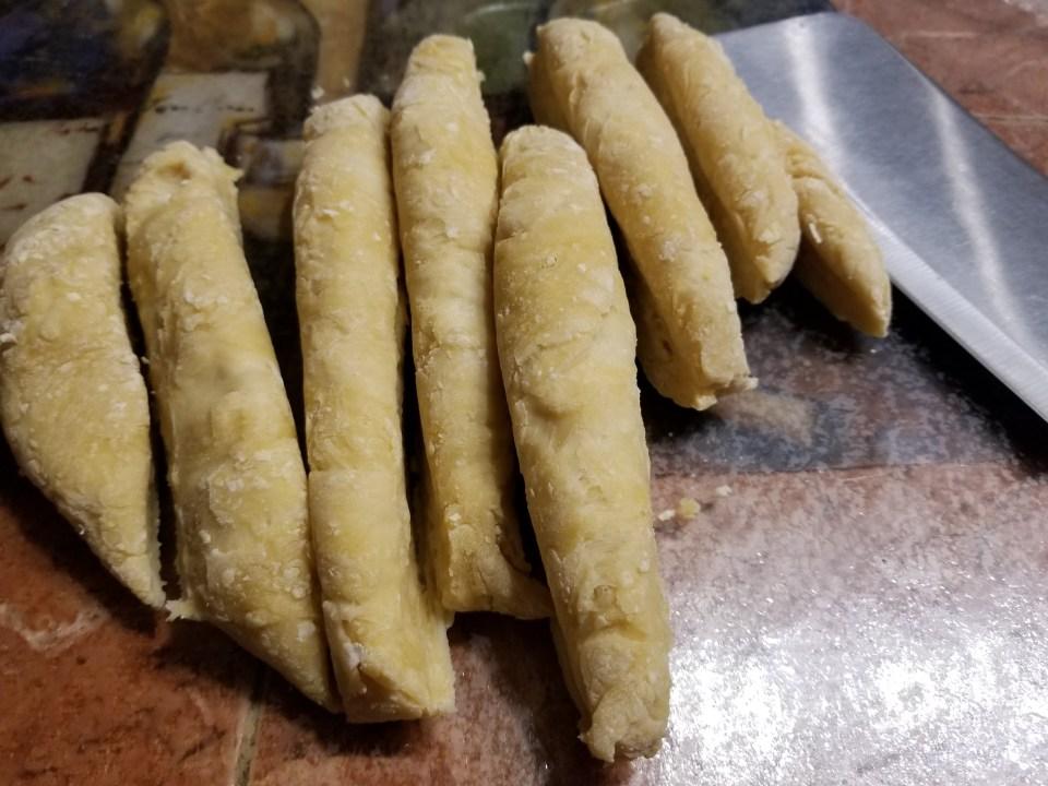 Homemade pasta dough divided into 8 portions