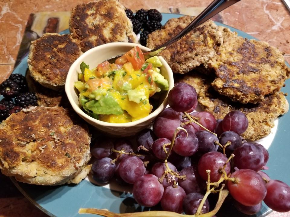 vegetarian platter: risotto cakes, chili bean cakes, mango avocado salsa, and red grapes